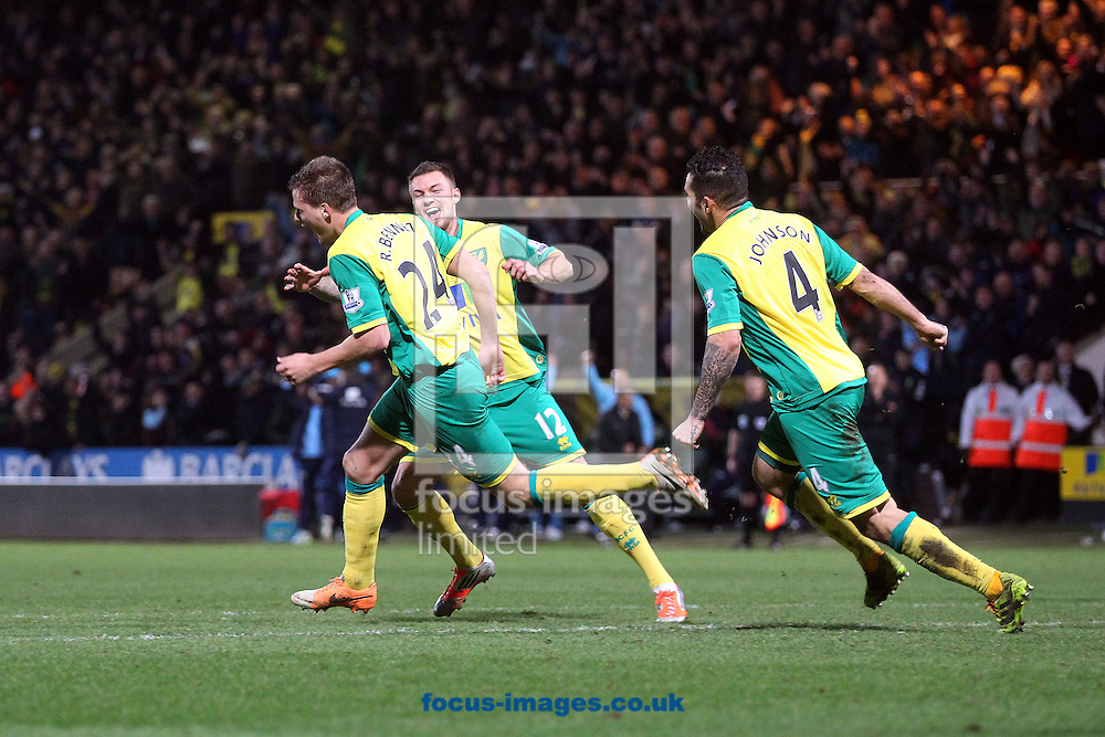 Picture by Paul Chesterton/Focus Images Ltd +44 7904 640267<br /> 18/01/2014<br /> Ryan Bennett of Norwich scores what turns out to be the winning goal and celebrates during the Barclays Premier League match at Carrow Road, Norwich.