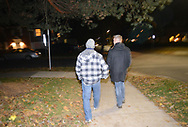 EDITORS PLEASE NOTE: WE WERE ONLY ALLOWED TO IDENTIFY AND SHOW FACES ON THREE OF THE MONITORS AND NOT ALLOWED TO IDENTIFY FRATERNITIES BY NAME: Danny Shaha, Interim Assistant Vice President - Student Rights & Responsibilitie and Barry Bram walk along Allen Street as party monitors check in on fraternities and sororities at Penn State University Saturday, November 11, 2017 in State College, Pennsylvania. (Photo by William Thomas Cain/CAIN IMAGES)