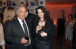 Left to right, PHILIP GREEN and NIGELLA LAWSON at a party to celebrate the 90th birthday of Vogue magazine held at The Serpentine Gallery, Kensington Gardens, London on 8th November 2006.<br />