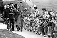 At the start of her Silver Jubilee Visit to N Ireland Queen Elizabeth II is greeted by local school children after her arrival by helicopter at Hillsborough Castle, her official residence whilst visiting the Province. Immediately behind her is Roy Mason, Secretary of State for N Ireland. 197708100074P<br /> <br /> Copyright Image from Victor Patterson, 54 Dorchester Park, <br /> Belfast, UK, BT9 6RJ<br /> <br /> t1: +44 28 9066 1296 (from Rep of Ireland 048 9066 1296)<br /> t2: +44 28 9002 2446 (from Rep of Ireland 048 9002 2446)<br /> m: +44 7802 353836<br /> <br /> e: victorpatterson@me.com<br /> www.victorpatterson.com<br /> <br /> Please see my Terms and Conditions of Use at www.victorpatterson.com. It is IMPORTANT that you familiarise yourself with them.<br /> <br /> Images used on the Internet must be visibly watermarked i.e. © Victor Patterson<br /> within the body of the image and copyright metadata must not be deleted. Images <br /> used on the Internet have a size restriction of 4kbs and will be chargeable at current<br />  NUJ rates unless agreed otherwise.<br /> <br /> This image is only available for the use of the download recipient i.e. television station, newspaper, magazine, book publisher, etc, and must not be passed on to any third <br /> party. It is also downloaded on condition that each and every usage is notified within 7 days to victorpatterson@me.com<br /> <br /> The right of Victor Patterson to be identified as the author is asserted in accordance with The Copyright Designs And Patents Act (1988). All moral rights are asserted.