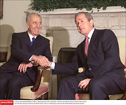 © Chuck KennedyKRT/ABACA. 25564-2. Washington-DC-USA, 03/05/2001. Israeli Foreign Minister Shimon Peres shakes hands with President George W. Bush at the White House. Peres is in Washington to discuss the stalled Middle East peace process.
