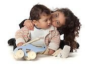 siblings love. Sister of five and brother of two showing affection On white Background