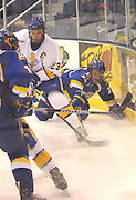 University of Alaska Fairbanks Bryant Molle (right)reaches with his stick to try to take the puck away from LSSU's Rick Schofield during the second period of UAF's Friday night game against the Lake Superior State Lakers at Taffy Abel Arena in Sault Ste. Marie, Michigan.