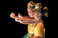 Two young western girls practice Balinese dance in a resort performance. Resort photography by Djuna Ivereigh.