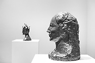 """Head of a Woman"" 1906 and ""The Jester"" 1905; Picasso Sculpture exhibit at MoMA."