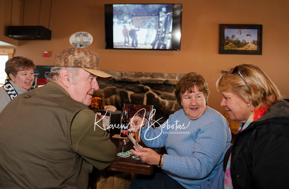 "Dawna Gauvin, Howard and Claire Smith and Judy Dupuis reminisce from ""back then"" in 1969 when they were skiing at Highlands Mountain Bike Park at the 50th anniversary celebration on Saturday.  (Karen Bobotas/for the Laconia Daily Sun)"