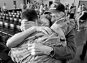 "Oklahoma National Guard Spc. Asa Barrett hugs his grandparents Dorothy and Clifford ""Bud"" Boyd as he and his brother, Spc. Mason Barrett, return to Oklahoma City, OK, with the 250 other soldiers of their unit after deployment in Afganistan."