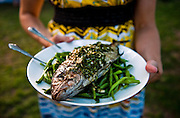 Jessica Maher of Dai Due serves grilled almaco jack with green beans and prsley sauce at the Dai Due Supper Club dinner featuring bycatch, relatively unknown fish that aren't usually prized at the dinner table.  The dinner was at Springdale Farm in east Austin.<br /> Ashley Landis for American Statesman