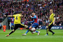 Connor Wickham of Crystal Palace passes the ball past Mario Suarez and Ben Watson of Watford - Mandatory by-line: Robbie Stephenson/JMP - 24/04/2016 - FOOTBALL - Wembley Stadium - London, England - Crystal Palace v Watford - The Emirates FA Cup Semi-Final
