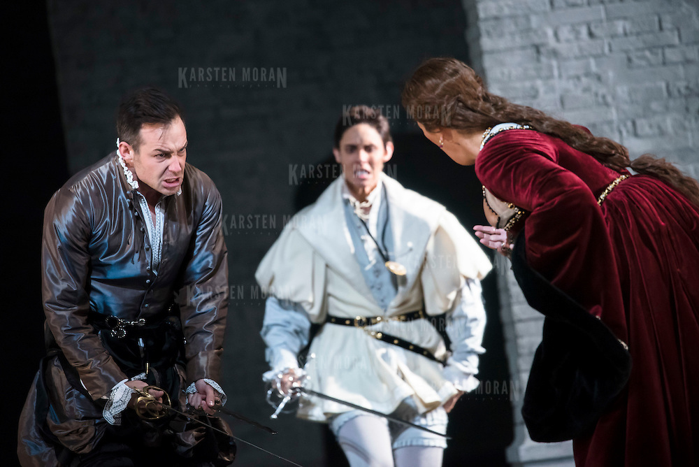 September 23, 2015 - New York, NY : From left, Stephen Costello (as Lord Richard Percy), Tamara Mumford (as Mark Smeaton), and Sondra Radvanovsky (as Anna Bolena) perform in a dress rehearsal for Gaetano Donizetti's 'Anne Bolena' at the Metropolitan Opera at Lincoln Center on Wednesday. CREDIT: Karsten Moran for The New York Times