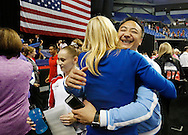 Coach Liang Chow gets a congratulatory hug from other coaches after his athlete, Rachel Gowey of Urbandale, was named to the US National Team and qualified for the Olympic trials Sunday, June 26, 2016, at the senior women's P&G Gymnastics Championships at Chaifetz Arena in St. Louis.