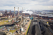 Nederland, Noord-Holland, Velsen, 16-04-2008; zicht op het terrein van Corus (voorheen Hoogovens), met cokesfabriek; rechts opslag erts, kolen, cokes; links in de achtergrond de eigenlijke hooghovens; het complex ligt in Velsen-Noord, naast het Noordzee kanaal, midden rechts de sluizen van het Noordzee kanaal; Corus: voorheen Hoogovens, gefuseerd met British Steel;.Corus steel industry, formely Hoogovens, part of the Tata Steel Group and produces hot-rolled, cold-rolled and metallic-coated steels; steel, iron, coke, ore, coal, cokes, chimney, blast furnaces...  .luchtfoto (toeslag); aerial photo (additional fee required); .foto Siebe Swart / photo Siebe Swart