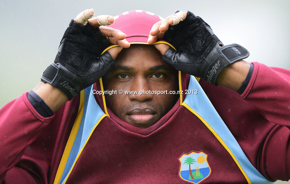 Marlon Samuels shelters himself from the rain on Day 2 of the 2nd cricket test match of the ANZ Test Series. New Zealand Black Caps v West Indies at The Basin Reserve in Wellington. Thursday 12 December 2013. Mandatory Photo Credit: Andrew Cornaga www.Photosport.co.nz