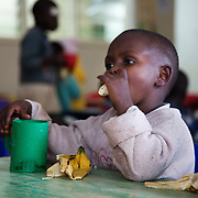 The Stars Foundation visiting Childline Kenya in Nairobi. ..At one of Childline Kenya's referral partners.  Afternoon snack: milk and banana...The help line number is 116, the first 3-digit only helpline number in Africa.