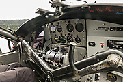 Cockpit of an old de Havilland Canada DHC-3 Otter seaplane preparing for take off from Beluga Lake seaplane base in Homer, Alaska.