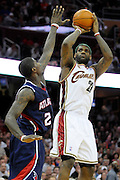 Cleveland Cavaliers forward LeBron James, right, shoots over Atlanta Hawks guard Joe Johnson during the fourth quarter in a NBA basketball game Friday, April 2, 2010 in Cleveland, Ohio. The Cavaliers beat the Hawks 93-88. (AP Photo/Jason Miller)