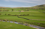 Stone barns, walls and a stream in fields on an early morning outside Bainbridge, Wensleydale, The Yorkshire Dales National Park, Yorkshire,<br /> England