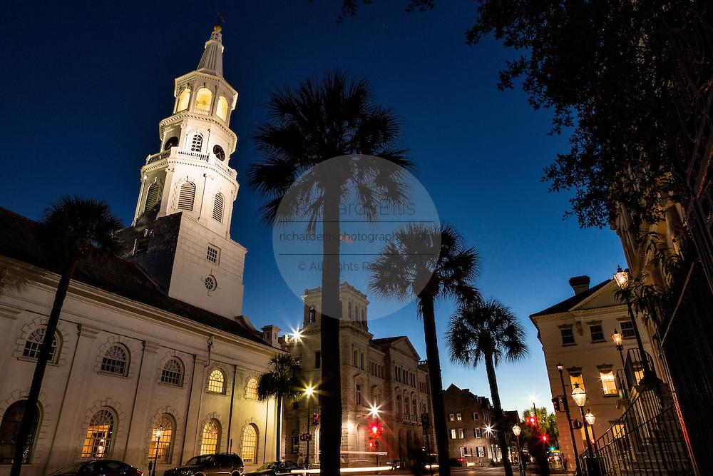 Steeple of St Michaels church at twilight along Broad Street in historic Charleston, SC.