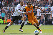 Hull midfielder Ahmed Elmohamady on the attack during the Sky Bet Championship play-off first leg match between Derby County and Hull City at the iPro Stadium, Derby, England on 14 May 2016. Photo by Aaron  Lupton.