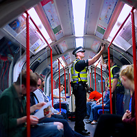 Police ride the London Underground towards Stratford Sation and the Olympic Park during the 2012 London Summer Olympics.