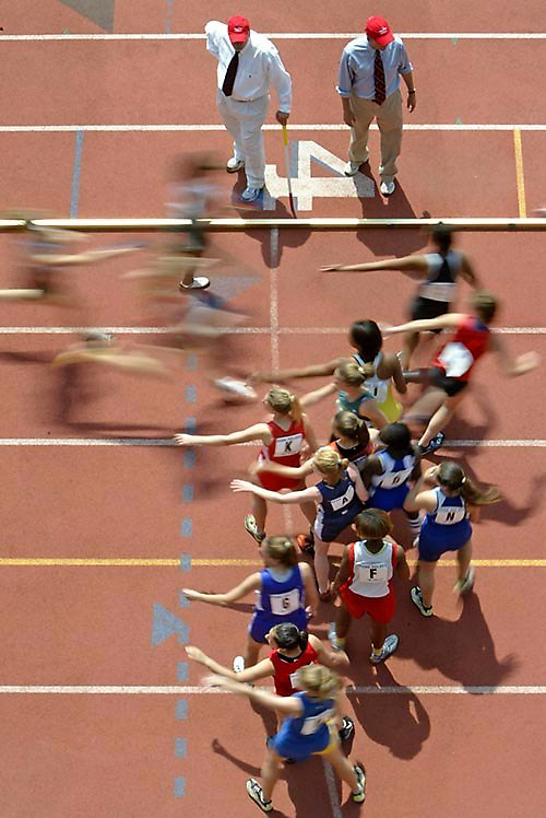Runners exchange batons during a high school 4x200 heat at the 2004 Penn Relays Carnival Thursday, April 22, 2004 in Philadelphia, PA..