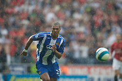 WIGAN, ENGLAND - Sunday, May 11, 2008: Wigan Athletic's Marcus Bent in action against Manchester United during the final Premiership match of the season at the JJB Stadium. (Photo by David Rawcliffe/Propaganda)