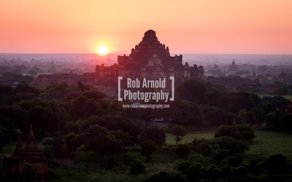 Sunrise over the ancient temples scattered through the misty Bagan landscape