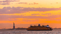 Statue of Liberty and Staten Island Ferry, New York Harbor, New York, New York USA.