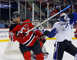 March 7, 2008; Newark, NJ, USA; Tampa Bay Lightning right wing Junior Lessard (42) and New Jersey Devils center Dainius Zubrus (16) come together during the first period at the Prudential Center in Newark, NJ.