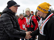 (L) Polish famous actor Cezary Pazura while medal ceremony with athete with intellectual disabilities during VIII Polish Winter Games Special Olympics at Wisla on February 26, 2012...Poland, Wisla, February 26, 2012..Picture also available in RAW (NEF) or TIFF format on special request...For editorial use only. Any commercial or promotional use requires permission...Photo by © Adam Nurkiewicz / Mediasport