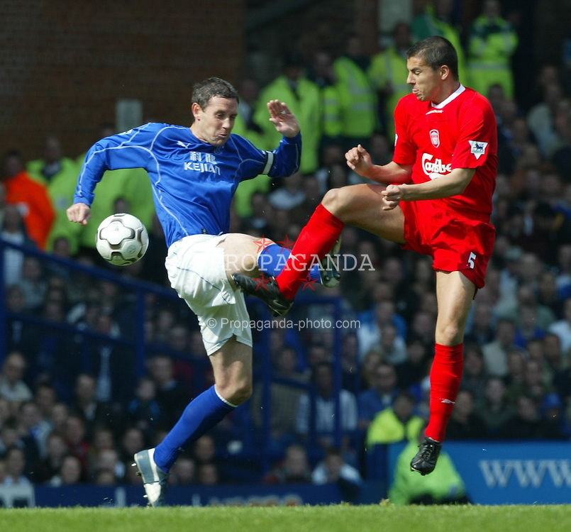 LIVERPOOL, ENGLAND - Saturday, April 19, 2003: Liverpool's Milan Baros and Everton's David Weir during the Merseyside Derby Premiership match at Goodison Park. (Pic by David Rawcliffe/Propaganda)