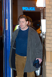 © London News Pictures. 15/03/2013 . London, UK.  MP Eric Joyce leaving Belgravia Police Station in London via a back door on March 15, 2013. Mr Joyce spent Thursday night in custody at a central London police station after an alleged drunken brawl at a House of Commons bar. Photo credit : Ben Cawthra/LNP
