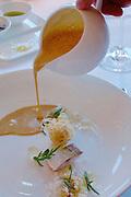 """Sylt, Germany. Hörnum. Budersand Hotel Golf & Spa. Restaurant KAI3.<br /> """"Consommé von Räucherfischen""""."""