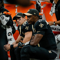Sep 16, 2018; New Orleans, LA, USA; New Orleans Saints quarterback Drew Brees (9) and quarterback Teddy Bridgewater (5) during the first quarter of a game against the Cleveland Browns at the Mercedes-Benz Superdome. Mandatory Credit: Derick E. Hingle-USA TODAY Sports