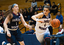 March 6 2016: Robert Morris Colonials guard Anna Niki Stamolamprou (4) drives to the basket against Fairleigh Dickinson Lady Knights guard Madelynn Comly (1) during the first half in the NCAA Women's Basketball game between the Fairleigh Dickinson Lady Knights and the Robert Morris Colonials at the Charles L. Sewall Center in Moon Township, Pennsylvania (Photo by Justin Berl)