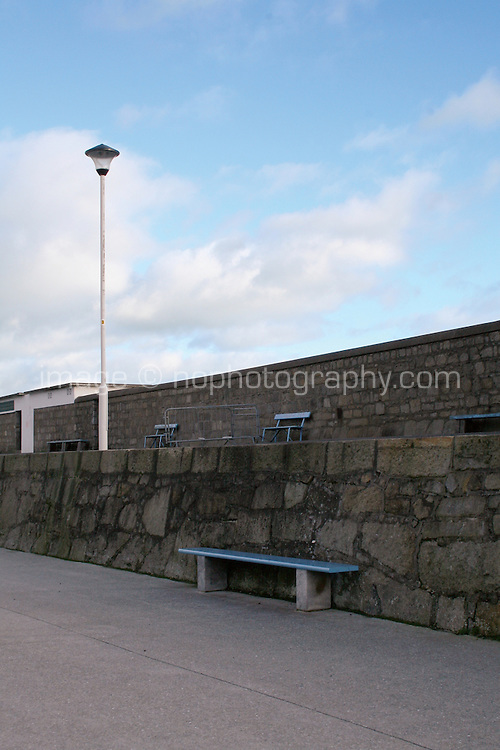 Benches along DunLaoghaire Pier Dublin Ireland in the winter