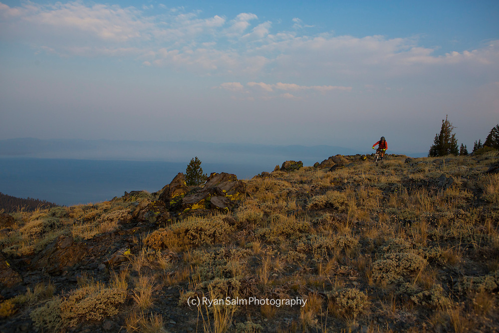 A wildfire inspired sunrise on The Bench, part of the Tahoe Rim Trail .<br /> <br /> Rider - Brennan Lagasse