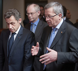 Jean-Claude Juncker, Luxembourg's prime minister, right, speaks with Nicolas Sarkozy, France's president, left, during the European Summit, in Brussels, on Thursday, March 25, 2010. (Photo © Jock Fistick)