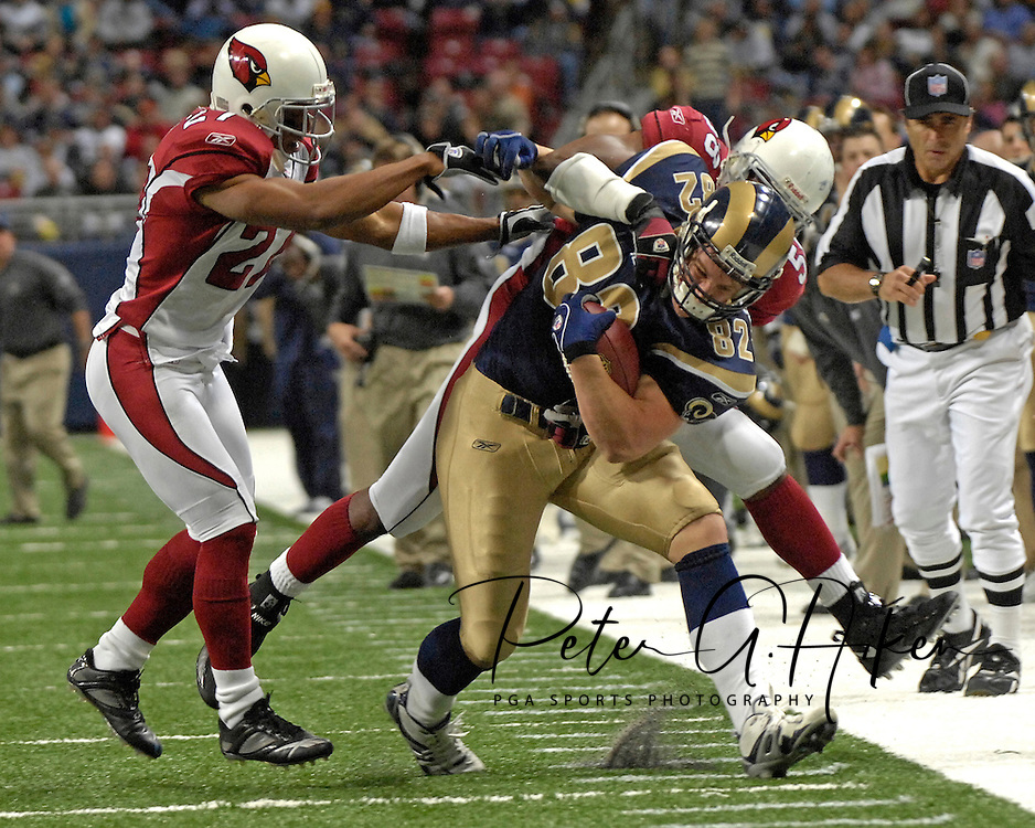 St. Louis Rams tight end Joe Klopfenstein (82) is ridden out of bounds by Arizona defenders David Macklin (27) and Chike Okeafor (56) in the second half, at the Edward Jones Dome in St. Louis, Missouri, December 3, 2006.  The Cardinals beat the Rams 34-20.<br />