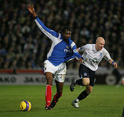 PORTSMOUTH, ENGLAND - SATURDAY, DECEMBER 9th, 2006: Kanu of Portsmouth clashes with Andy Johnson of Everton during the Premiership match at Fratton Park. (Pic by Chris Ratcliffe/Propaganda)