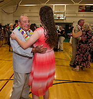 John Gauthier and Katey Fecteau enjoy a dance together during Laconia High School's Senior / Senior Hawaiian themed prom held at the Laconia Community Center Thursday evening.  Mr. Gauthier is a 1938 graduate of LHS and class president for two years.  (Karen Bobotas/for the Laconia Daily Sun)