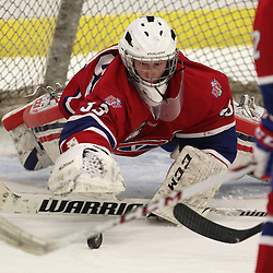Buffalo, NY - Feb 17 : Ontario Junior Hockey League game action between the Buffalo Junior Sabres and the Kingston Voyaguers, Alexander Brooks-Potts #33 of the Kingston Voyageurs Hockey Club makes a save during the third period. (Photo By Timothy T. Ludwig / OHJL Images)