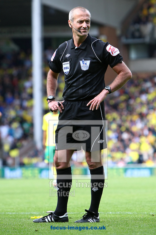 Picture by Paul Chesterton/Focus Images Ltd.  07904 640267.13/05/12.Referee Martin Atkinson during the Barclays Premier League match at Carrow Road Stadium, Norwich.