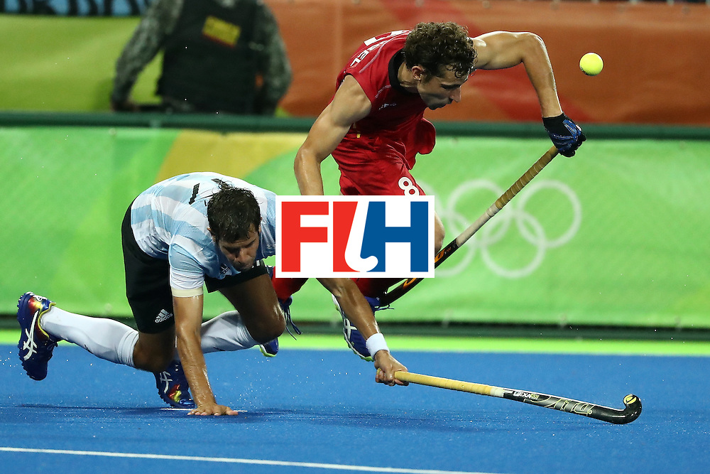 RIO DE JANEIRO, BRAZIL - AUGUST 18:  Florent van Aubel #8 of Belgium competes for the ball during the Men's Hockey Gold Medal match between Belgium and Argentina on Day 13 of the Rio 2016 Olympic Games at Olympic Hockey Centre on August 18, 2016 in Rio de Janeiro, Brazil.  (Photo by Sean M. Haffey/Getty Images)