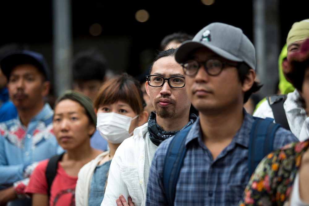 TOKYO, JAPAN - JULY 5 : Supporters watch the campaign speech of candidate Yohei Miyake for 2016 July's House of Councillors elections outside Shinjuku Station on July 5, 2016, Tokyo, Japan. (Photo: Richard Atrero de Guzman/NUR Photo)