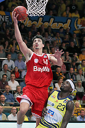 11.10.2014, ENERVIE Arena, Hagen, GER, Beko Basketball BL, Phoenix Hagen vs FC Bayern Muenchen, 4. Runde, im Bild Nihad Djedovic (FC Bayern Muenchen #14) beim Korbleger gegen Larry Gordon (Phoenix Hagen #23) // during the Beko Basketball Bundes league 4th round match between Phoenix Hagen and FC Bayern Muenchen at the ENERVIE Arena in Hagen, Germany on 2014/10/11. EXPA Pictures © 2014, PhotoCredit: EXPA/ Eibner-Pressefoto/ Schueler<br /> <br /> *****ATTENTION - OUT of GER*****