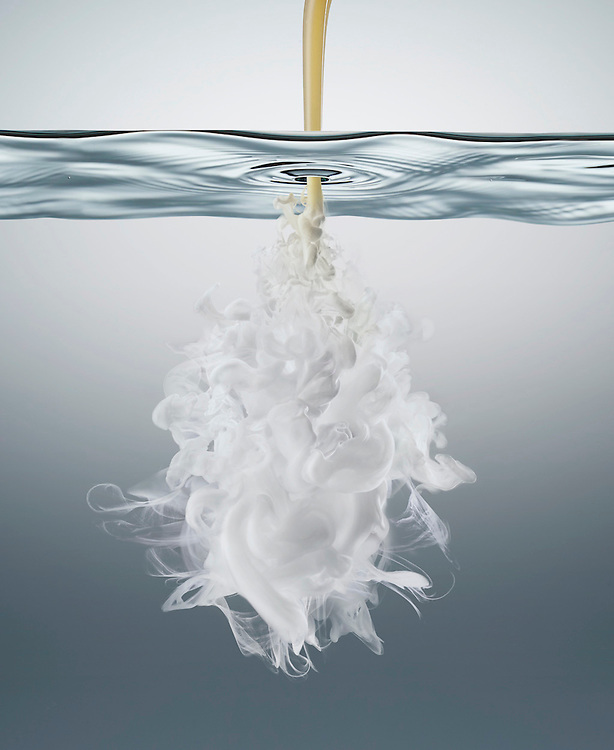 Aveeno Oil under the water surface creating white clouds Ray Massey is an established, award winning, UK professional  photographer, shooting creative advertising and editorial images from his stunning studio in a converted church in Camden Town, London NW1. Ray Massey specialises in drinks and liquids, still life and hands, product, gymnastics, special effects (sfx) and location photography. He is particularly known for dynamic high speed action shots of pours, bubbles, splashes and explosions in beers, champagnes, sodas, cocktails and beverages of all descriptions, as well as perfumes, paint, ink, water – even ice! Ray Massey works throughout the world with advertising agencies, designers, design groups, PR companies and directly with clients. He regularly manages the entire creative process, including post-production composition, manipulation and retouching, working with his team of retouchers to produce final images ready for publication.