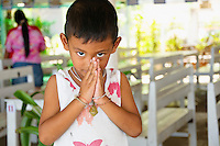 Wai greeting from a child, Ban Phe, Thailand