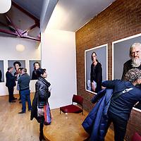 """Nederland, Amsterdam , 11 januari 2014.<br /> opening van de expositie van Koos Breukel in de Valeriuskliniek.<br /> Nu de verhuizing van de Valeriuskliniek naar De Nieuwe Valerius een feit is, heeft portretfotograaf Koos Breukel een unieke portretserie van cliënten en (ex-)medewerkers van de Valeriuskliniek gemaakt. Breukel opereert aan de top van de Nederlandse portretfotografie en is onder meer bekend van de staatsieportretten van koning Willem-Alexander en koningin Maximá. Breukel heeft zijn sporen ook verdiend met projecten waarin de kracht van zijn portret in humane projecten centraal stonden.Coördinator kunstzaken Joke Stoute vertelt enthousiast: """"Aanvankelijk kwamen de mensen die op de foto wilden binnendruppelen , maar al snel liep het storm. We konden de toeloop nog maar net aan. Cliënten, medewerkers, het was fantastisch om te zien met hoeveel plezier iedereen voor de camera verscheen."""" En iedereen die meedeed, heeft een foto van zichzelf meegekregen, met een handtekening van Koos Breukel.""""<br /> Foto:Jean-Pierre Jans"""