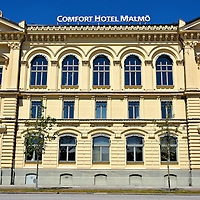 Comfort Hotel Old Building in Malmö, Sweden <br /> The Comfort Hotel Malmö has nearly 300 rooms, making it the largest hotel in the city. It consists of two buildings. This yellow one with the ornamental arched windows, pilaster columns and dentil cornice dates back to 1898. The new wing (not shown) was finished in 2011. It is located near the harbor and directly across from the Central Station and the new City Tunnel.